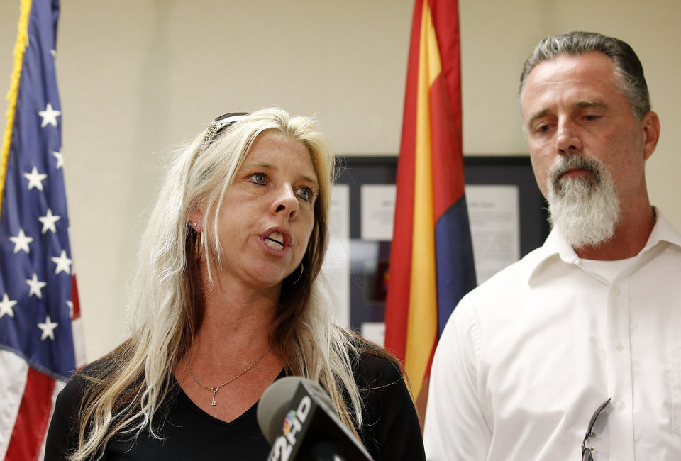 Photo - Family members of the victims, Jeanne Brown, left, who had a sister and father murdered, speaks during a news conference as her husband Richard Brown listens, after the nearly two hour long execution of Joseph Rudolph Wood at the state prison on Wednesday, July 23, 2014, in Florence, Ariz. (AP Photo)