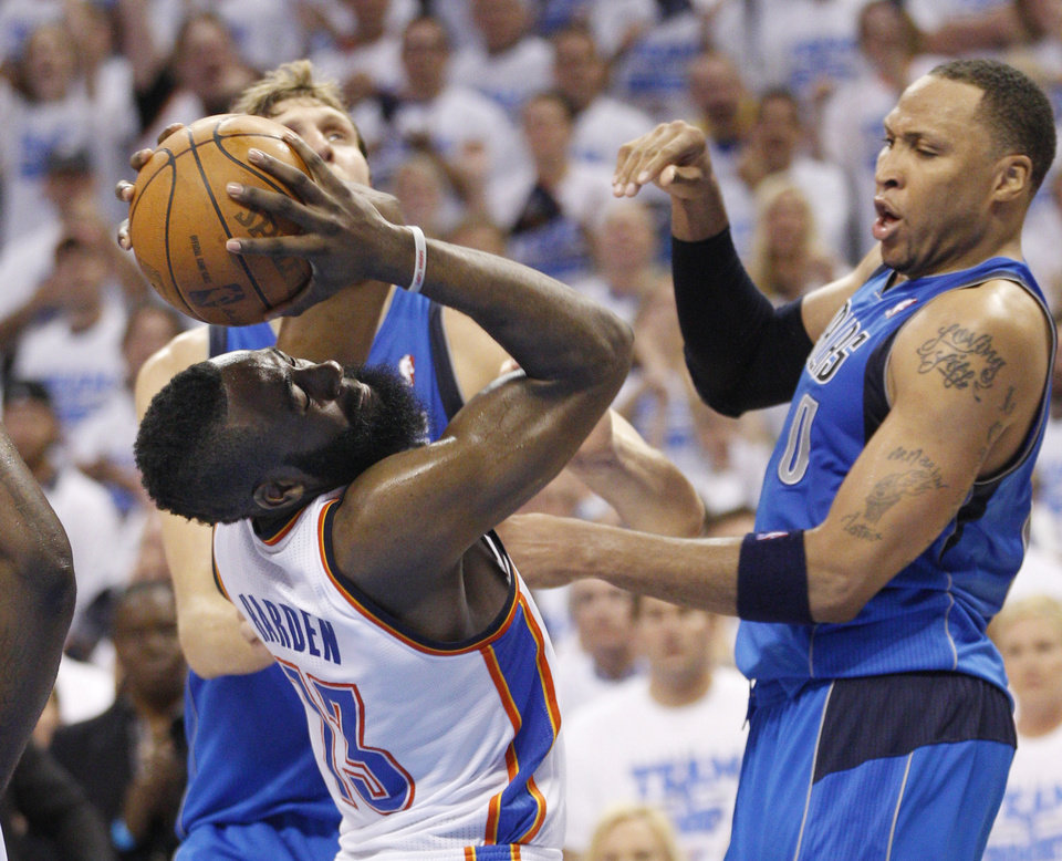 Photo -   Oklahoma City Thunder guard James Harden (13) is fouled by Dallas Mavericks forward Shawn Marion, right, late in the fourth quarter of Game 2 in the first round of the NBA basketball playoffs, in Oklahoma City, Monday, April 30, 2012. Harden converted on both free throws and Oklahoma City won the game 102-99. (AP Photo/Sue Ogrocki)