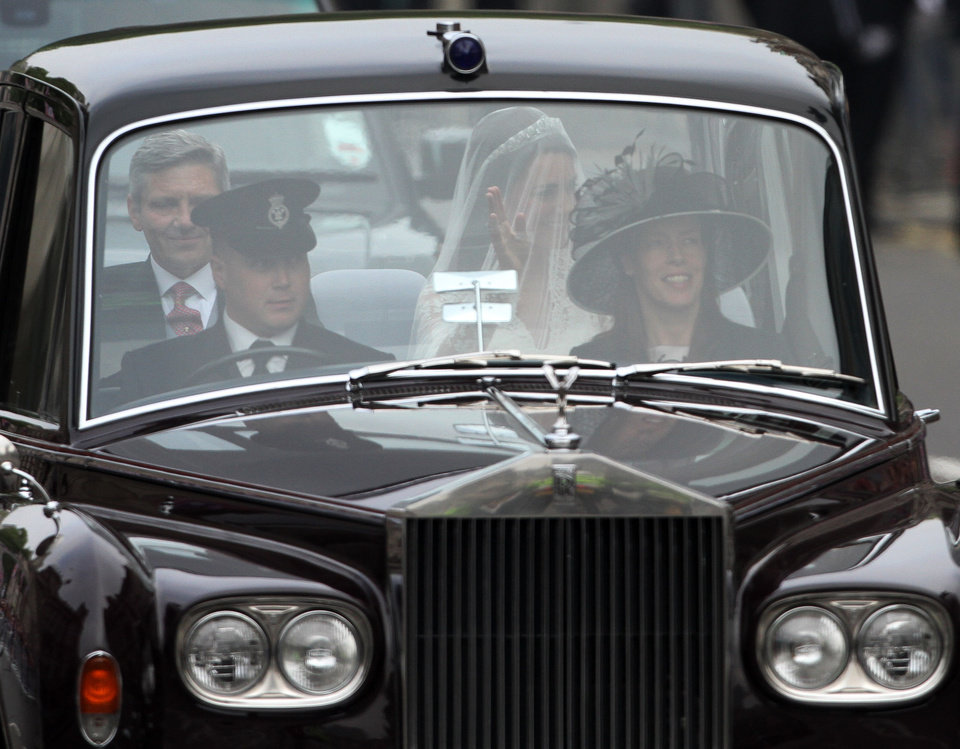Photo - Kate Middleton, back right, makes her way to Westminster Abbey with her father Michael Middleton before the Royal Wedding in London Friday, April, 29, 2011. (AP Photo/Tim Hales)  ORG XMIT: RWAT113
