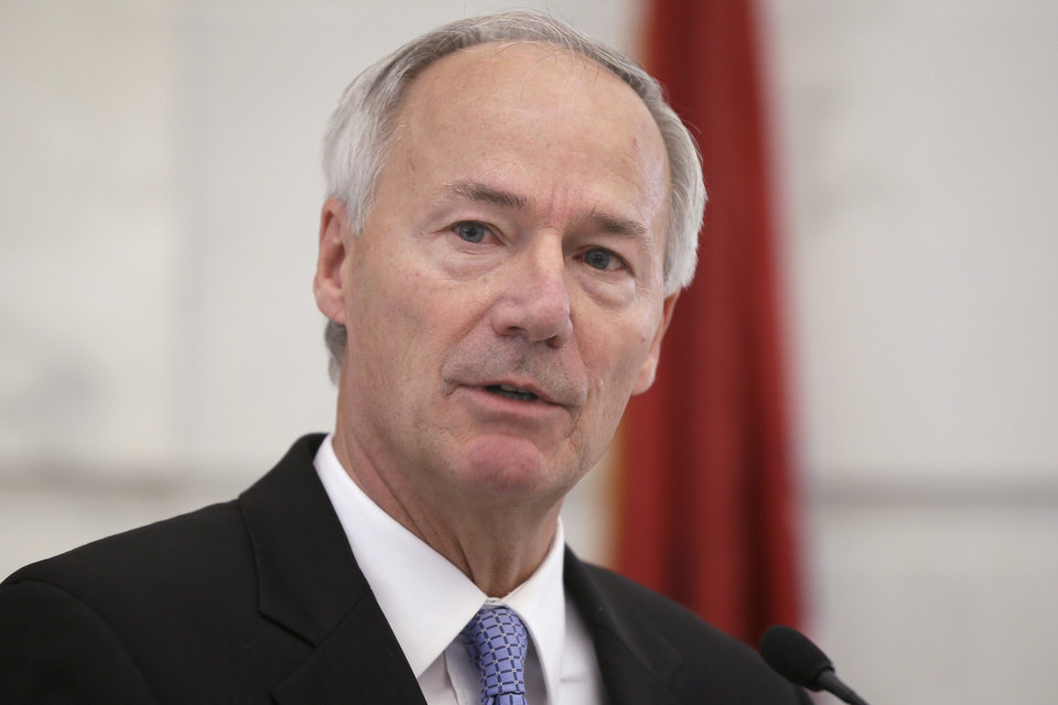 Photo - Arkansas Gov.-elect Asa Hutchinson speaks to reporters at the Arkansas state Capitol in Little Rock, Ark., Tuesday, Nov. 25, 2014. Surgeon General Joe Thompson and a spokesman for Hutchinson said Tuesday the incoming governor told Thompson he won't be reappointed when Hutchinson takes office in January. (AP Photo/Danny Johnston)