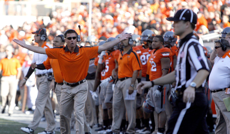 Photo - Oklahoma State head coach Mike Gundy argues a call during a college football game between the Oklahoma State University Cowboys (OSU) and the Baylor University Bears (BU) at Boone Pickens Stadium in Stillwater, Okla., Saturday, Oct. 29, 2011. Photo by Sarah Phipps, The Oklahoman