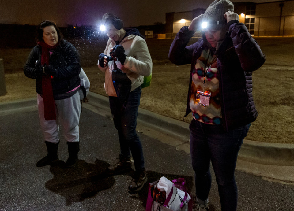 Photo - Kelli Lynch, Theresa Seitz and Amy Newberry, from left, get their gear together as they prepare to interview homeless population during the city's annual Point-in-Time homeless count in Oklahoma City, Okla. on Thursday, Jan. 23, 2020.   [Chris Landsberger/The Oklahoman]