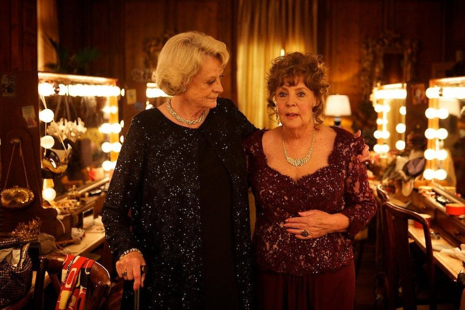 Photo - Maggie Smith, left, and Pauline Collins in a scene from