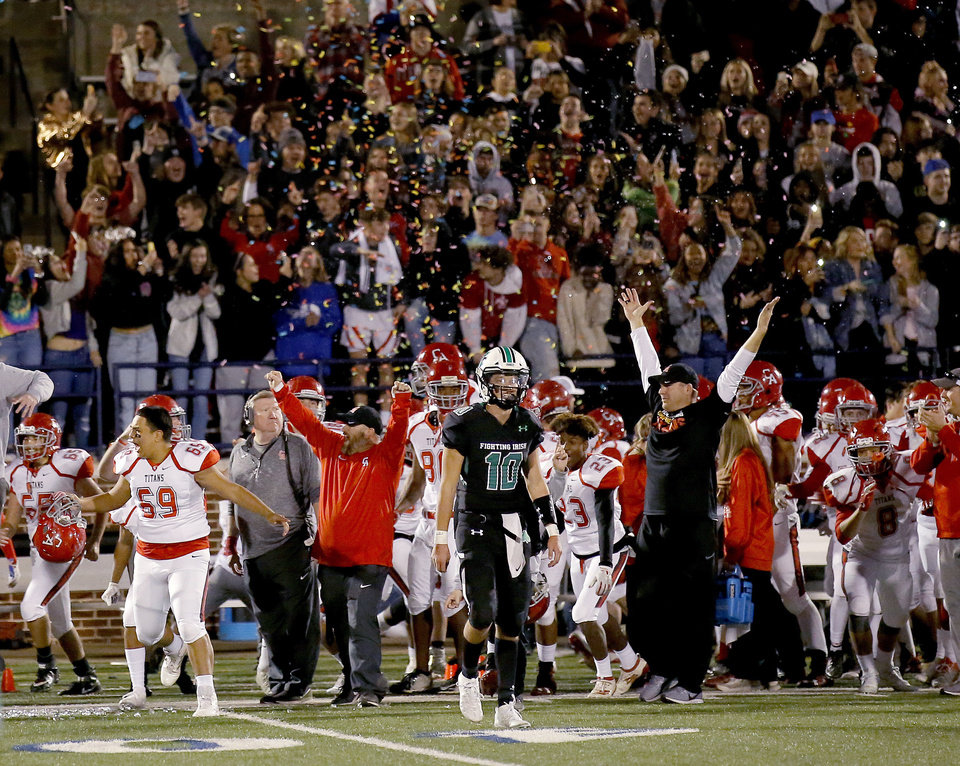 Photo - McGuinness's Luke Tarman walks off the field as Carl Albert celebrates the 5A state football championship between McGuinness and Carl Albert at Wantland Stadium in Edmond, Okla., Saturday, Dec. 7, 2019. [Sarah Phipps/The Oklahoman]