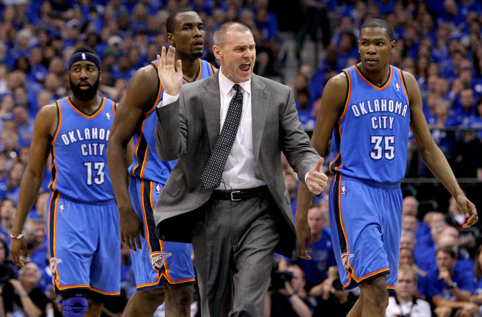 Photo - Dallas coach Rick Carlisle walks towards an official in front of Oklahoma City's James Harden (13), Serge Ibaka (9), and Kevin Durant (35) during game 1 of the Western Conference Finals in the NBA basketball playoffs between the Dallas Mavericks and the Oklahoma City Thunder at American Airlines Center in Dallas, Tuesday, May 17, 2011. Photo by Bryan Terry, The Oklahoman