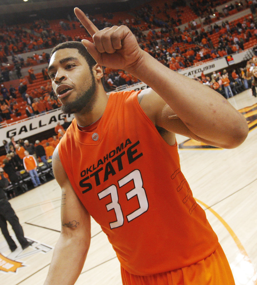 Photo - OSU's Marshall Moses (33) reacts after the men's college basketball game between Oklahoma State University (OSU) and Kansas State University (KSU) at Gallagher-Iba Arena in Stillwater, Okla., Saturday, January 8, 2011. OSU won, 76-62. Photo by Nate Billings, The Oklahoman