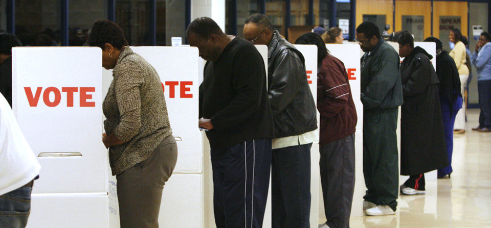 Photo - Voters line up in the voting booths at precinct 551 to vote at Millwood High School in Oklahoma City Tuesday, Nov. 4, 2008. BY PAUL B. SOUTHERLAND, THE OKLAHOMAN