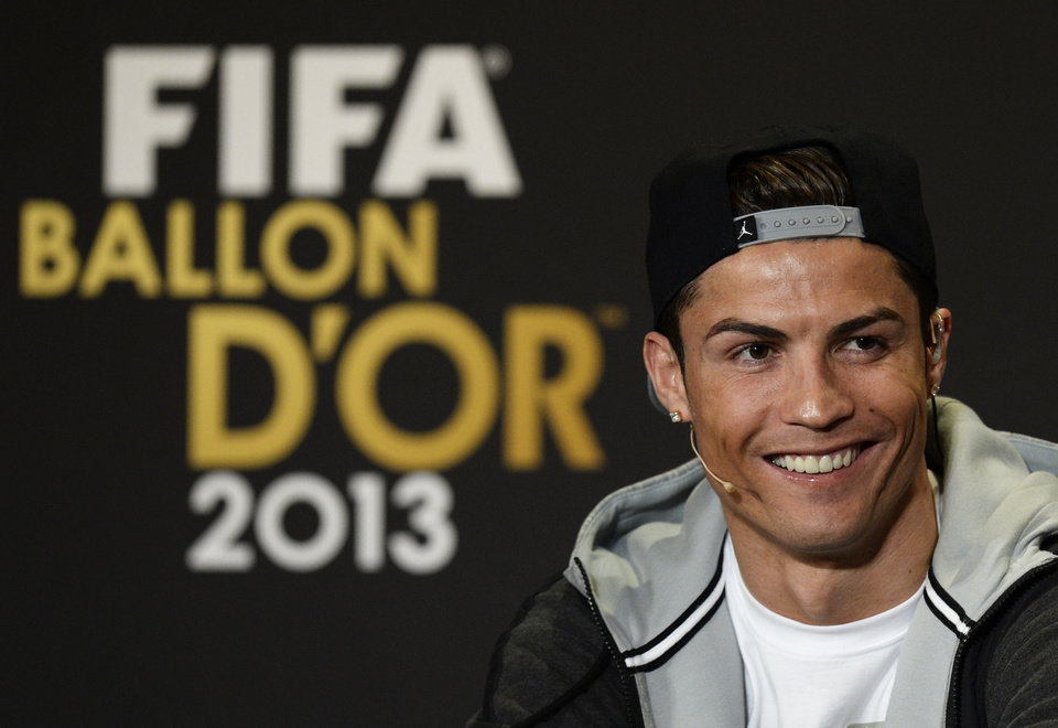 Photo - Cristiano Ronaldo of Portugal, one of the nominees for the Men's World Soccer  Player of the year, speaks during a press conference at the FIFA Ballon d'Or awarding ceremony  in Zurich, Switzerland, Monday, Jan. 13, 2014. (AP Photo/Keystone,Steffen Schmidt)