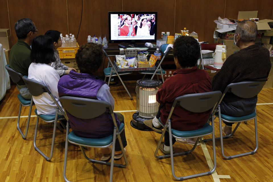 Photo - Evacuees watch the royal wedding by Prince William and Kate Middleton on TV at a shelter for victims of the earthquake and tsunami in Ishinomaki, Miyagi Prefecture, northeastern Japan, Friday, April 29, 2011. (AP Photo/Hiro Komae) ORG XMIT: XHK112