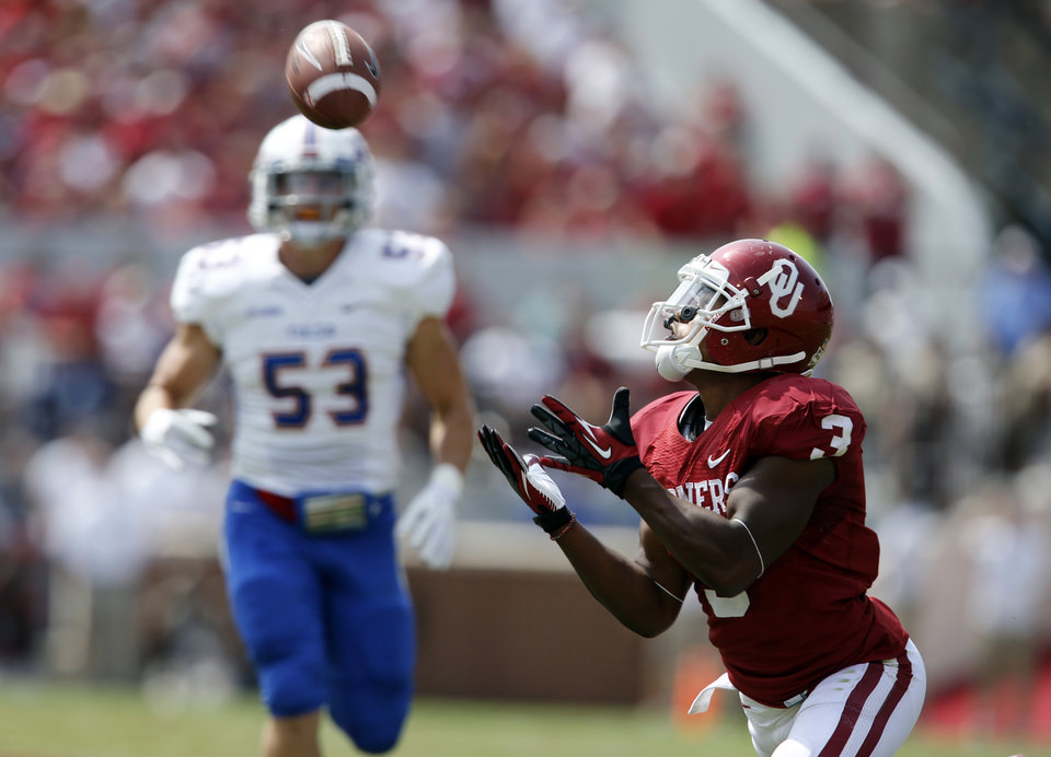 Photo - Oklahoma's Sterling Shepard (3) makes a long pass reception during the first half of a college football game between the University of Oklahoma Sooners (OU) and the Tulsa Golden Hurricane (TU) at Gaylord Family-Oklahoma Memorial Stadium in Norman, Okla., on Saturday, Sept. 14, 2013. Photo by Steve Sisney, The Oklahoman