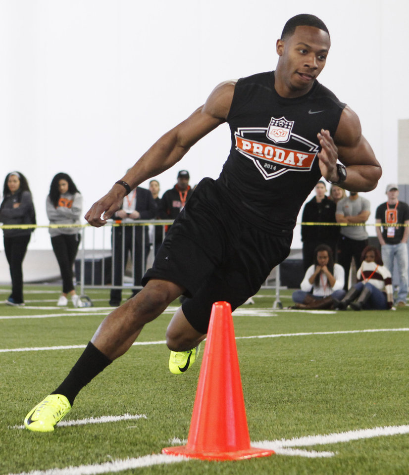 Photo - Corner back Justin Gilbert runs a drill during a workout at Oklahoma State's pro day held at Boone Pickens Stadium in Stillwater on Thursday, March 13, 2014. Photo by KT King, The Oklahoman