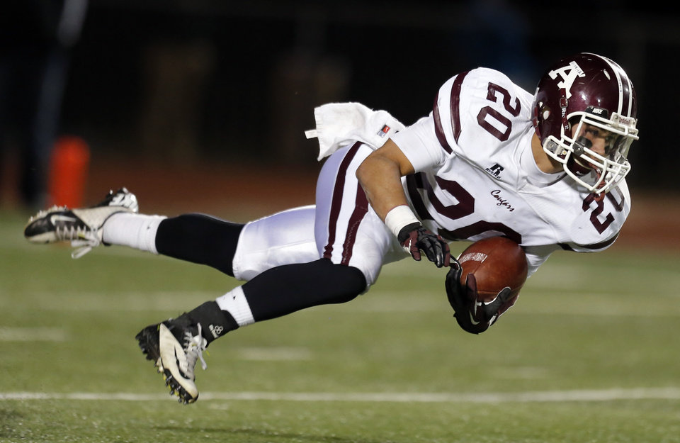 Photo - Ada's Mason Girdley dives forward during the high school playoff game between Ada and Clinton at Putnam City High School in Oklahoma City, Friday, Nov. 23, 2012. Photo by Sarah Phipps, The Oklahoman