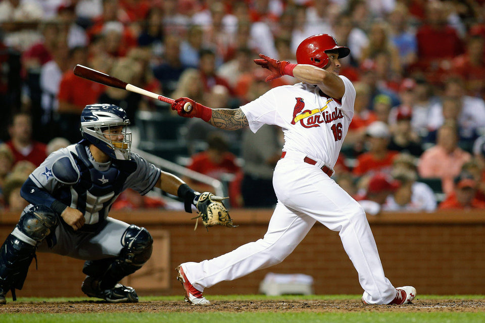 Photo - St. Louis Cardinals' Kolten Wong follows through on a RBI single to score Jon Jay during the fourth inning of a baseball game against the San Diego Padres Friday, Aug. 15, 2014, in St. Louis. (AP Photo/Scott Kane)