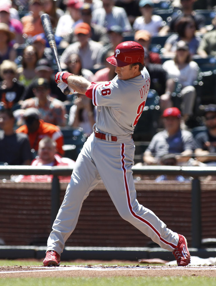 Photo - Philadelphia Phillies' Chase Utley hits an RBI-triple against the San Francisco Giants during the first inning of a baseball game, Sunday, Aug. 17, 2014, in San Francisco. (AP Photo/George Nikitin)