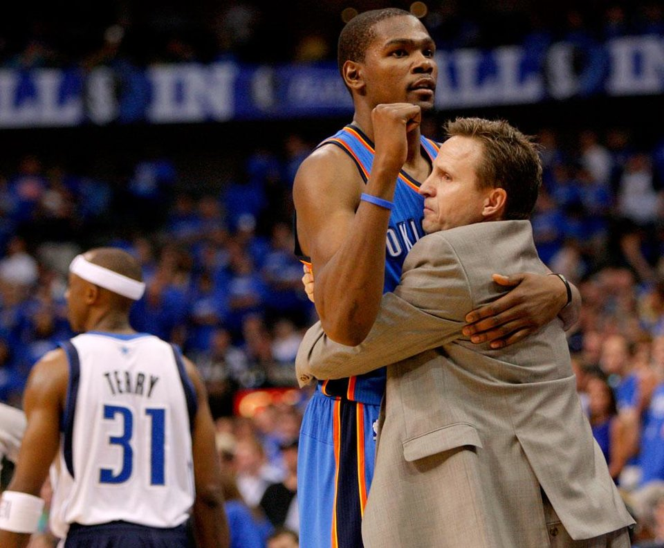Oklahoma City's Kevin Durant (35) celebrates with coach Scott Brooks beside Dallas' Jason Terry (31) during Game 4 of the first round in the NBA playoffs between the Oklahoma City Thunder and the Dallas Mavericks at American Airlines Center in Dallas, Saturday, May 5, 2012. Oklahoma City won 103-97. Photo by Bryan Terry, The Oklahoman