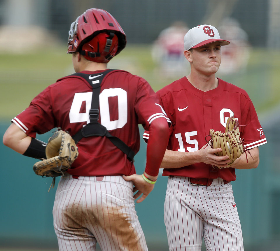 Photo - Oklahoma's Wyatt Olds (15) stands next to Brady Lindsly (40) before getting pulled from the game in the fifth inning of a Big 12 baseball tournament game between the University of Oklahoma (OU) and TCU at Chickasaw Bricktown Ballpark in Oklahoma City, Okla., Thursday, May 23, 2019.  [Bryan Terry/The Oklahoman]