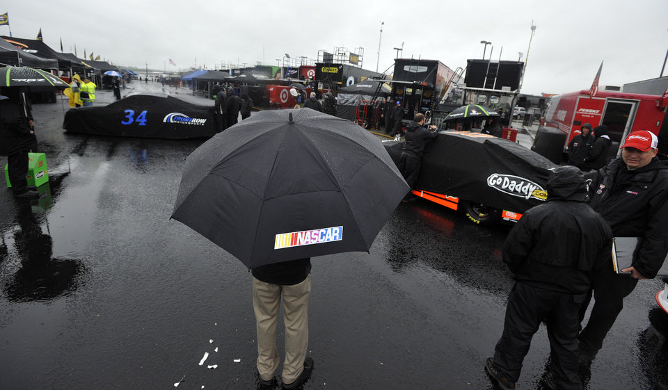 Photo - Rain dampens the activity outside the Grand National Garage at Talladega Superspeedway in Talladega, Ala., Saturday, May 4, 2013. Rain threatens Saturday's qualifying for Sunday's Aaron's 499 auto race. (AP Photo/Rainier Ehrhardt)