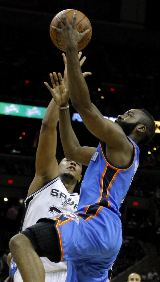 Oklahoma City\'s James Harden (13) goes past San Antonio\'s Boris Diaw (33) during Game 2 of the Western Conference Finals between the Oklahoma City Thunder and the San Antonio Spurs in the NBA playoffs at the AT&T Center in San Antonio, Texas, Tuesday, May 29, 2012. Photo by Bryan Terry, The Oklahoman