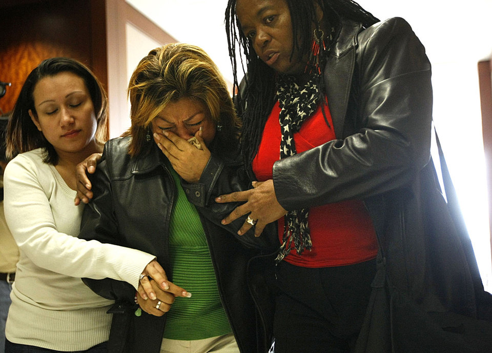 Rosie Castillo, center, grandmother of 16-month-old day care fire victim, Elias Castillo, reacts after walking out of closing arguments where home day care operator Jessica Tata is on trial for one count of felony murder at the Harris County Criminal Justice Center, Monday, Nov. 12, 2012, in Houston. Tata was charged after leaving seven children, between the ages of 15 months and 3 years old unattended to go shopping when a fire started in the home that killed four children at a Houston woman's home day care Feb. 24, 2011. Tata faces up to life in prison if convicted on that charge, though jurors can find her guilty on several lesser counts. (AP Photo/Houston Chronicle, Johnny Hanson)