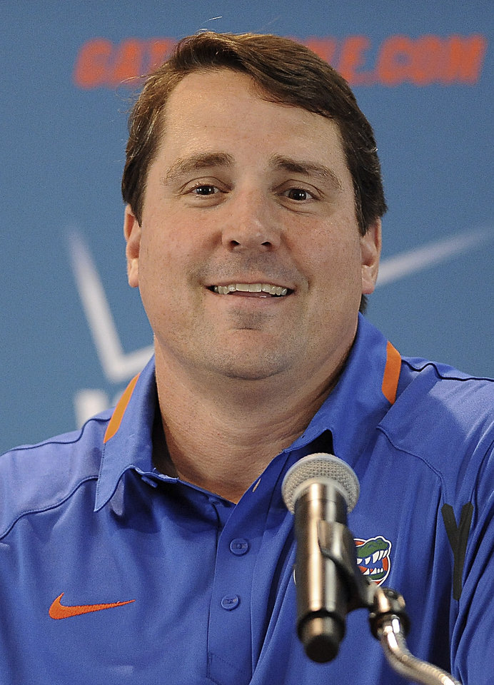 Photo - Florida NCAA college head football coach Will Muschamp smiles at the teams media day in Gainesville, Fla., Sunday, Aug. 3, 2014.  (AP Photo/Phil Sandlin)