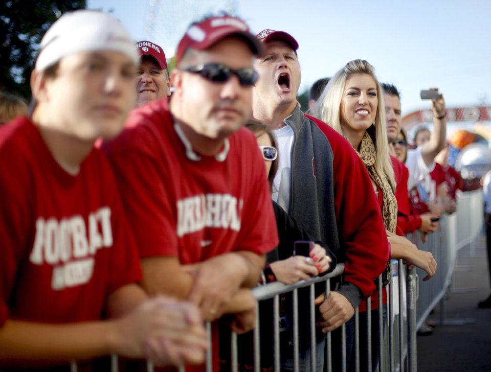 Photo - Blake Bailey of Muskogee, Okla, cheers as the team arrives before the Red River Rivalry college football game between the University of Oklahoma Sooners (OU) and the University of Texas Longhorns (UT) at the Cotton Bowl in Dallas, Texas, Saturday, Oct. 17, 2009. Photo by Bryan Terry, The Oklahoman