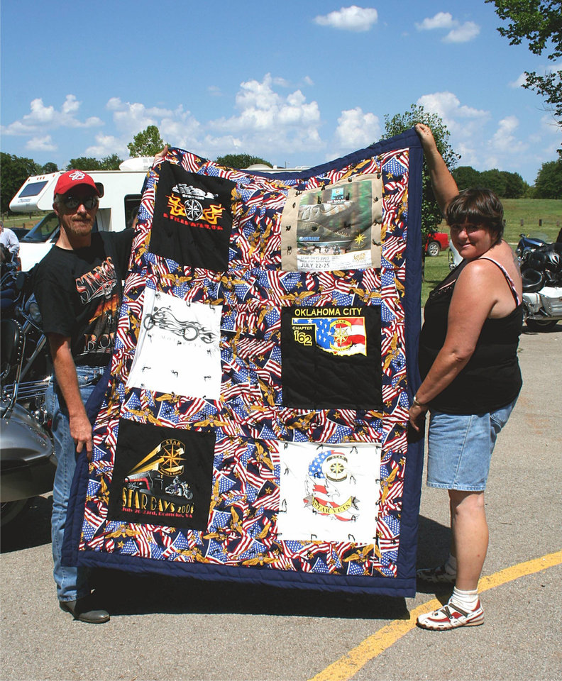 Star Chapter 162 of the Star Touring and Riding Motorcycle Association had their first multi-chapter ride-in and picnic at the Choctaw Park.  The Star chapter from Tulsa and the north OKC chapter 378 also joined them in the festivities.  The Quilt seen here was won in the raffle by Steve Roberts of chapter 378 shown here with the quilt's maker JC Brasher, wife of Chapter 162's president, Tom Brasher.<br/><b>Community Photo By:</b> Garry Baird<br/><b>Submitted By:</b> Garry, Oklahoma City