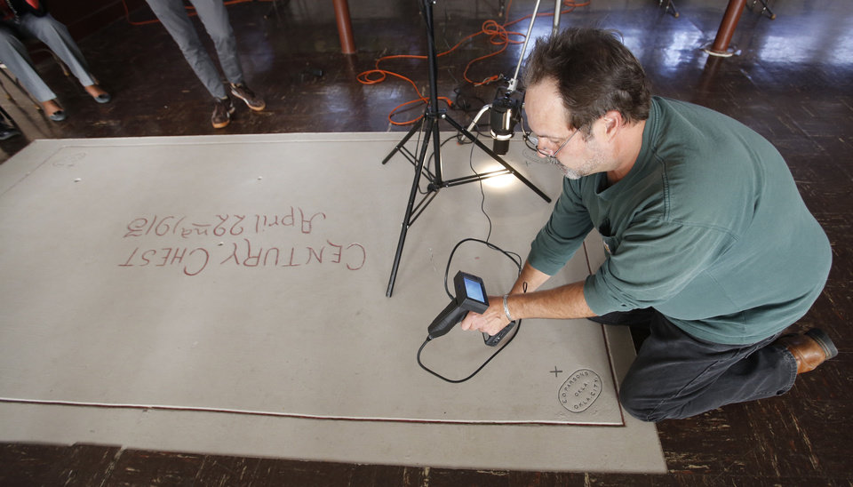 Photo - Videographer Andy Slaucitajs uses special equipment to see inside the vault-like structure that houses a 100-year-old time capsule at First Lutheran Church of Oklahoma City, 1300 N Robinson. Photo by Steve Gooch, The Oklahoman  Steve Gooch - The Oklahoman