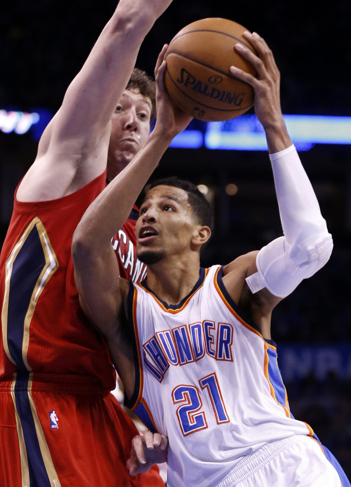Photo - Thunder's Andre Roberson (21) drives past Pelican's Omer Asik (3) during the second half of an NBA basketball game between the Oklahoma City Thunder and the New Orleans Pelicans at Chesapeake Energy Arena on Dec. 21, 2014 in Oklahoma City, Okla. Photo by Steve Sisney, The Oklahoman