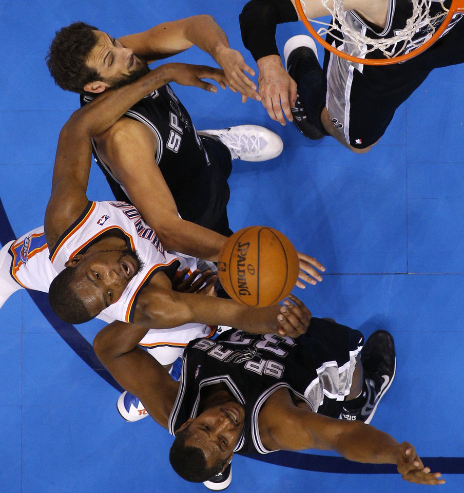 Photo - Oklahoma City's Kevin Durant (35) fights for the ball between San Antonio's Marco Belinelli (3) and Boris Diaw (33) during Game 3 of the Western Conference Finals in the NBA playoffs between the Oklahoma City Thunder and the San Antonio Spurs at Chesapeake Energy Arena in Oklahoma City, Sunday, May 25, 2014. Photo by Bryan Terry, The Oklahoman