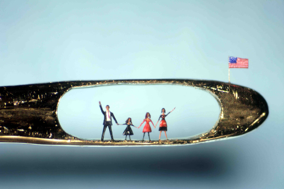 Photo - This undated image provided by UKFineArts Tuesday Jan. 20 2009, shows a micro sculpture by Willard Wigan showing U.S,  President  elect Barrack Obama and his family in the eye of a needle. Barack Obama will be inaugurated as the 44th U.S. president in Washington on Tuesday.  (AP Photo/ UKFineArts,HO) **  NO SALES EDITORIAL USE ONLY  ** ORG XMIT: LON141