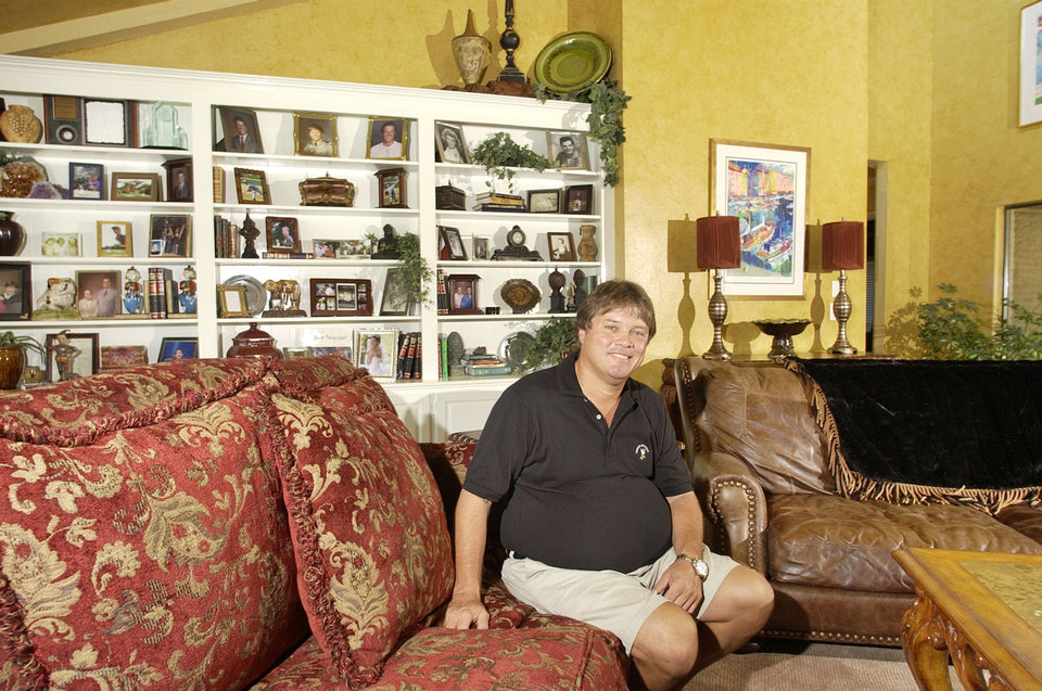 Photo - Teddy Mitchels is shown in 2004 in the living room of his home at 640 NW 150 in Oklahoma City.  PAUL B. SOUTHERLAND