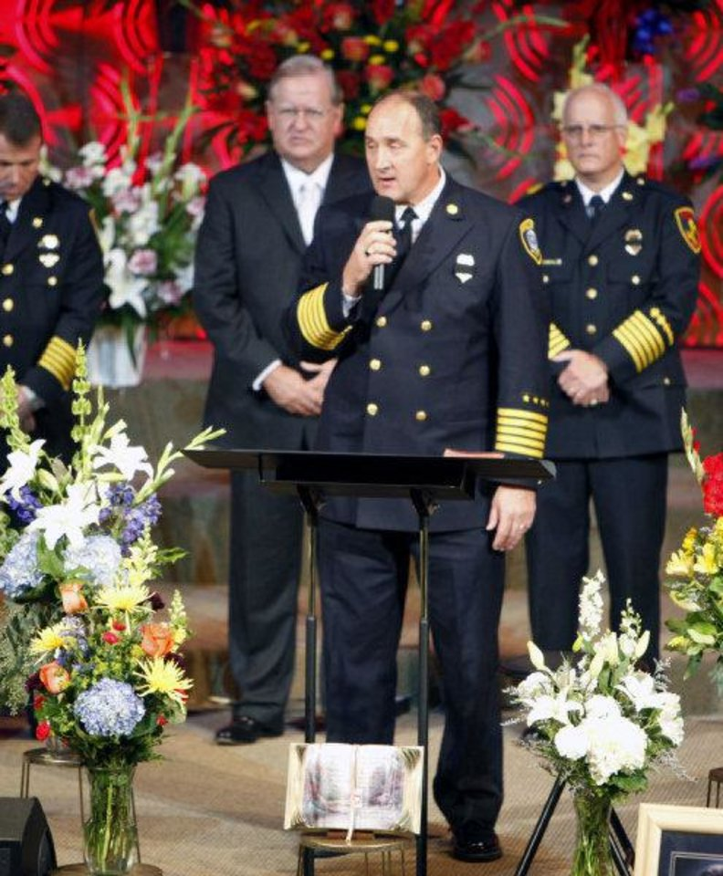 Photo - Oklahoma City Fire Chief Keith Bryant talks at the funeral of Nichols Hills Fire Chief Keith Bryan on Saturday at The Bridge Assembly of God in Mustang.  PAUL HELLSTERN