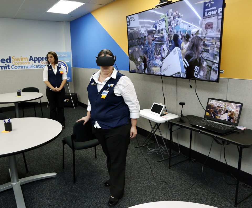 Photo -  Department Manager Rachel Smith experiences a Black Friday virtual reality scenario at a Walmart Academy in Del City.