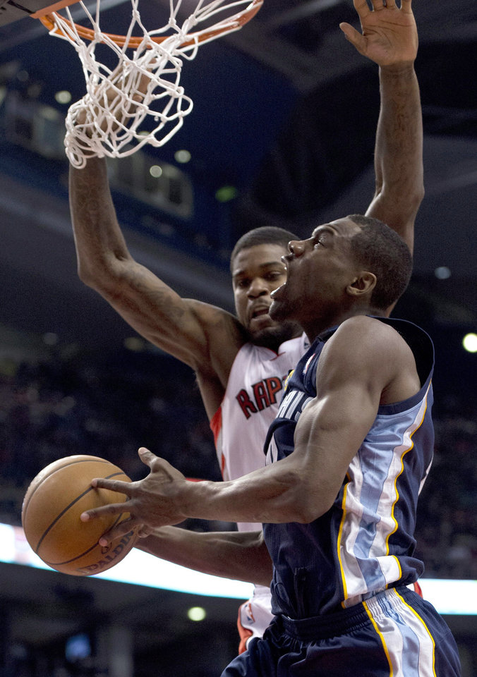 Memphis Grizzlies guard Tony Allen, front, tries to drive to the basket against Toronto Raptors forward Amir Johnson during the first half of an NBA basketball game in Toronto on Wednesday, Feb. 20, 2013. (AP Photo/The Canadian Press, Frank Gunn)