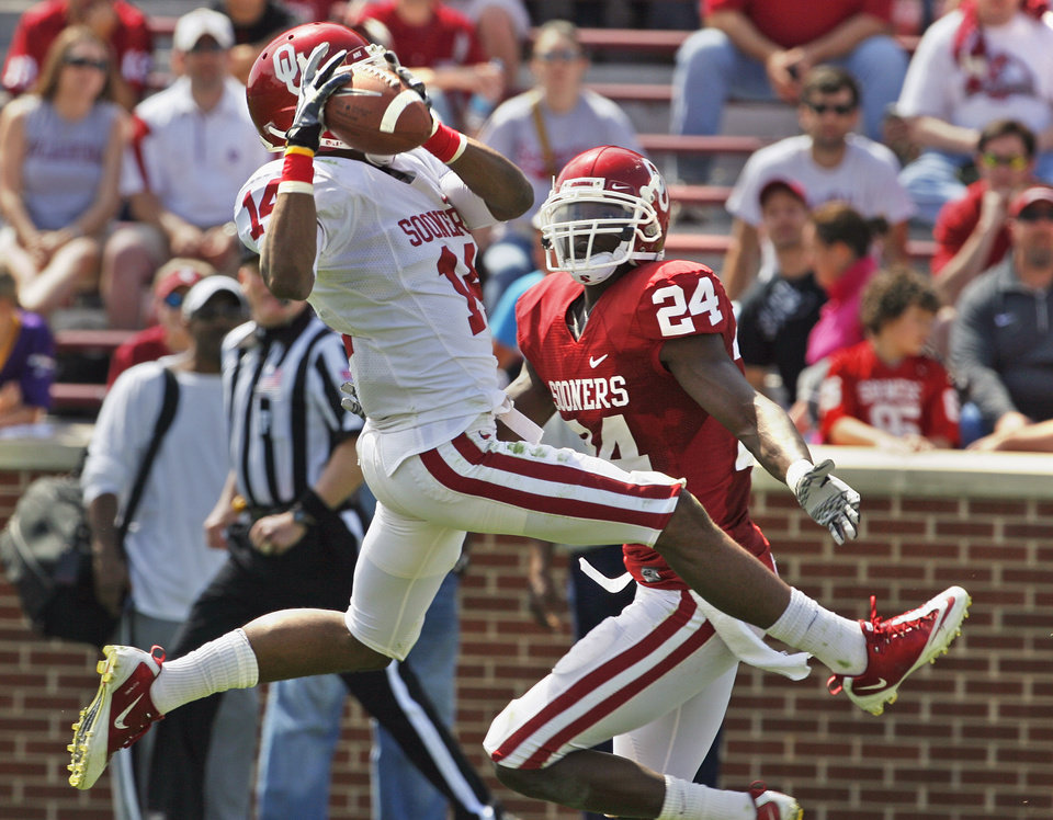 Devensive back Aaron Colvin (14) intercepts a pass intended for Dejuan Miller (24) during the University of Oklahoma Sooner's (OU) Spring Football game at Gaylord Family-Oklahoma Memorial Stadium on Saturday, April 16, 2011, in Norman, Okla.  