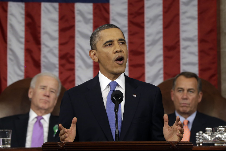 President Barack Obama, flanked by Vice President Joe Biden and House Speaker John Boehner of Ohio, gives his State of the Union address during a joint session of Congress on Capitol Hill in Washington, Tuesday Feb. 12, 2013. (AP Photo/Charles Dharapak, Pool) ORG XMIT: CAP515