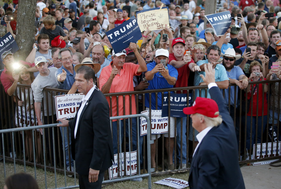 Photo - Donald Trump supporters cheer as the Republican presidential candidate waves takes the stage during a rally at the Oklahoma State Fair in Oklahoma City, Friday, September 25, 2015. Photo by Bryan Terry, The Oklahoman