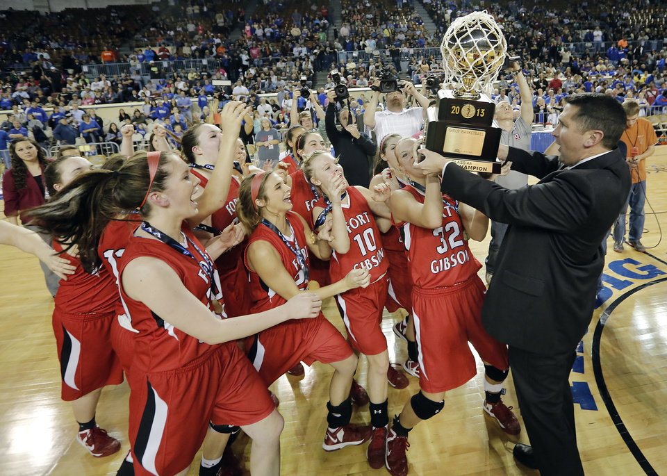 Fort Gibson celebrates with the gold ball trophy after the win over Mount Saint Mary during the state high school basketball tournament Class 4A girls championship game between Fort Gibson High School and Mount St. Mary High School at the State Fair Arena on Saturday, March 9, 2013, in Oklahoma City, Okla. Photo by Chris Landsberger, The Oklahoman