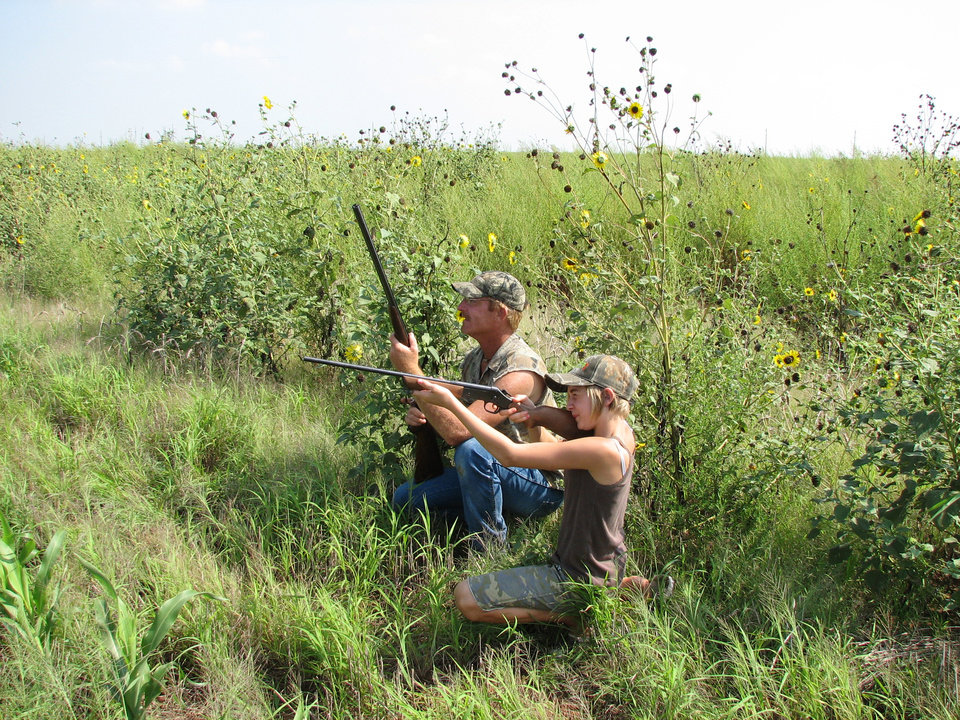 Photo - Dove shoots are a good way to introduce kids and newcomers to hunting. Dove season opens Tuesday statewide and of the hunting seasons in Oklahoma, only the opening day of deer gun season is more eagerly anticipated. Photo by Ed Godfrey, The Oklahoman