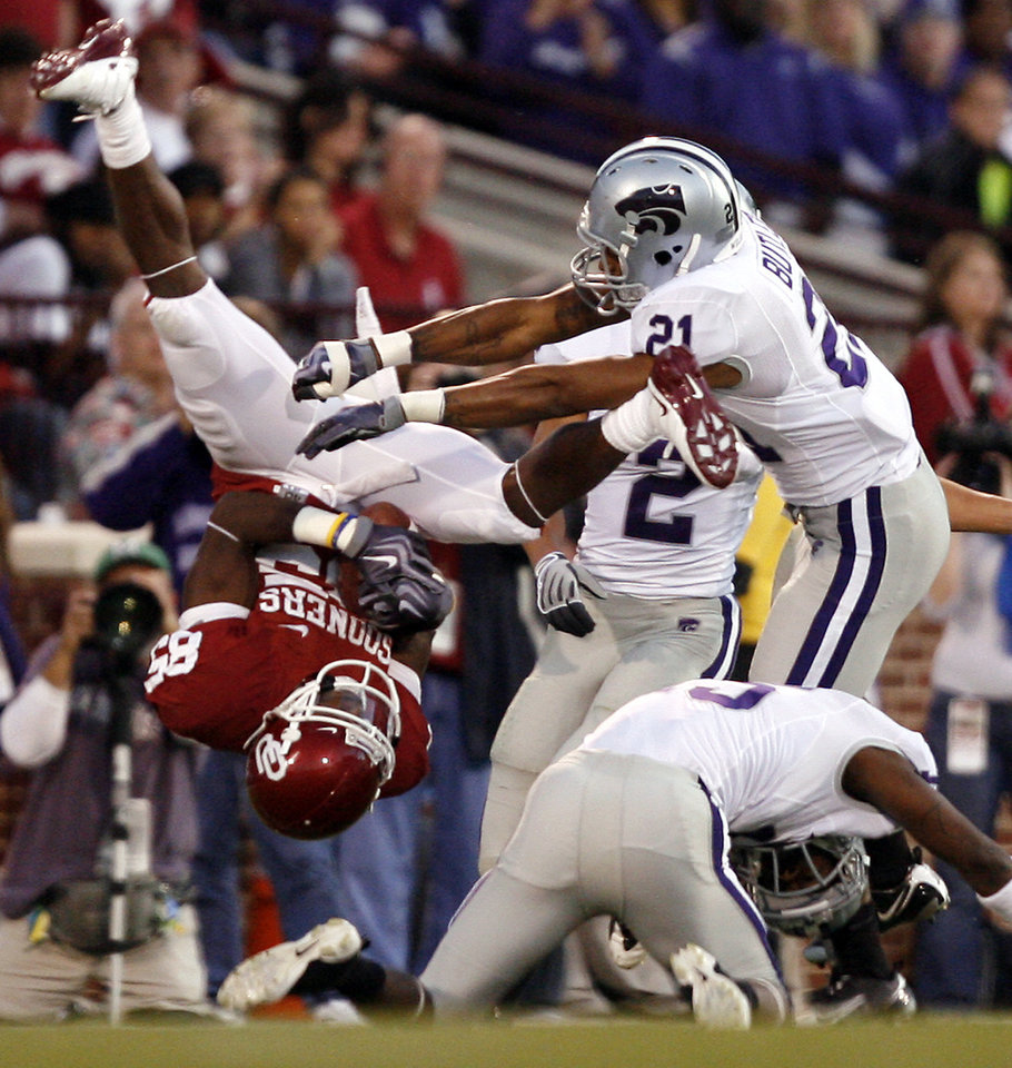 Oklahoma\'s Ryan Broyles (85) is upended by Kansas State\'s Troy Butler (21) after a reception during the first half of the college football game between the University of Oklahoma Sooners (OU) and the Kansas State University Wildcats (KSU) at the Gaylord Family -- Oklahoma Memorial Stadium on Saturday, Oct. 31, 2009, in Norman, Okla. Photo by Chris Landsberger, The Oklahoman