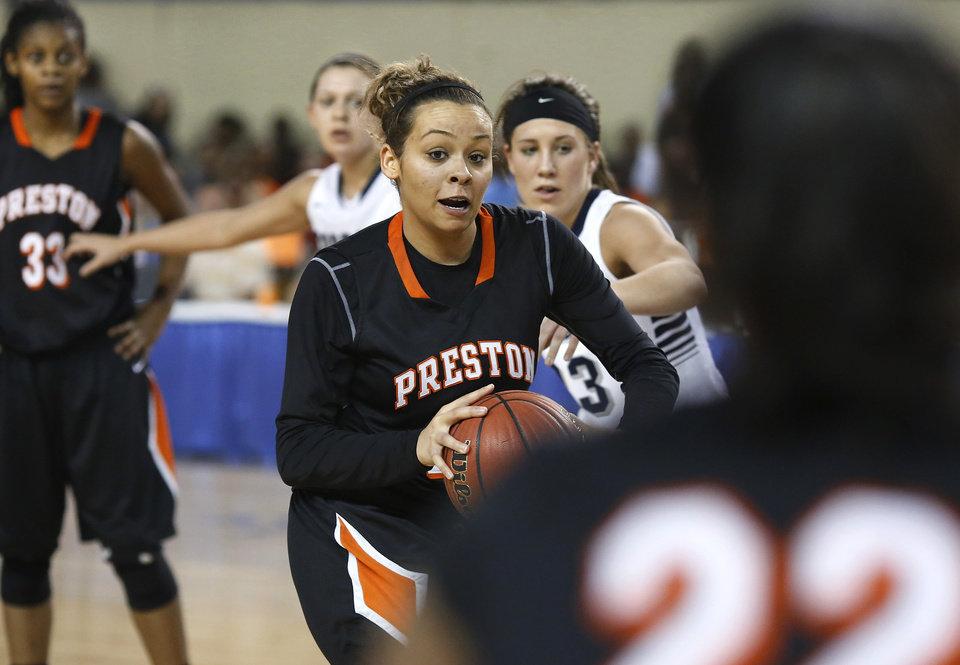 Photo - Preston's Chelsea Dungee before she passes the ball to teammate Danielle Hawkins during the Class 2A Girls State Championship game between Preston and Cordell at Jim Norick Arena at State Fair Park  on Saturday, Mar. 15, 2014.  Preston won,  45-41. Photo by Jim Beckel, The Oklahoman