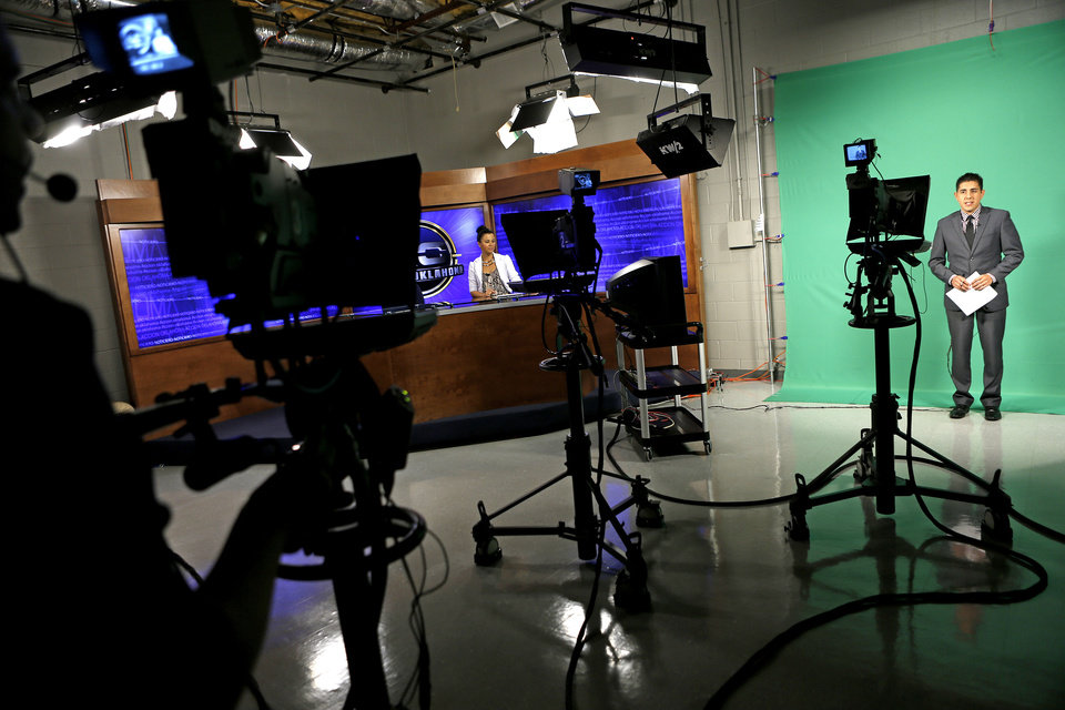 Ubaldo Martinez and Jessica Cano, left,   during an Accion Oklahoma newscast on KTUZ-TV, a Telemundo affiliate in Oklahoma City, Wednesday, July 3, 2013. Photo by Bryan Terry, The Oklahoman