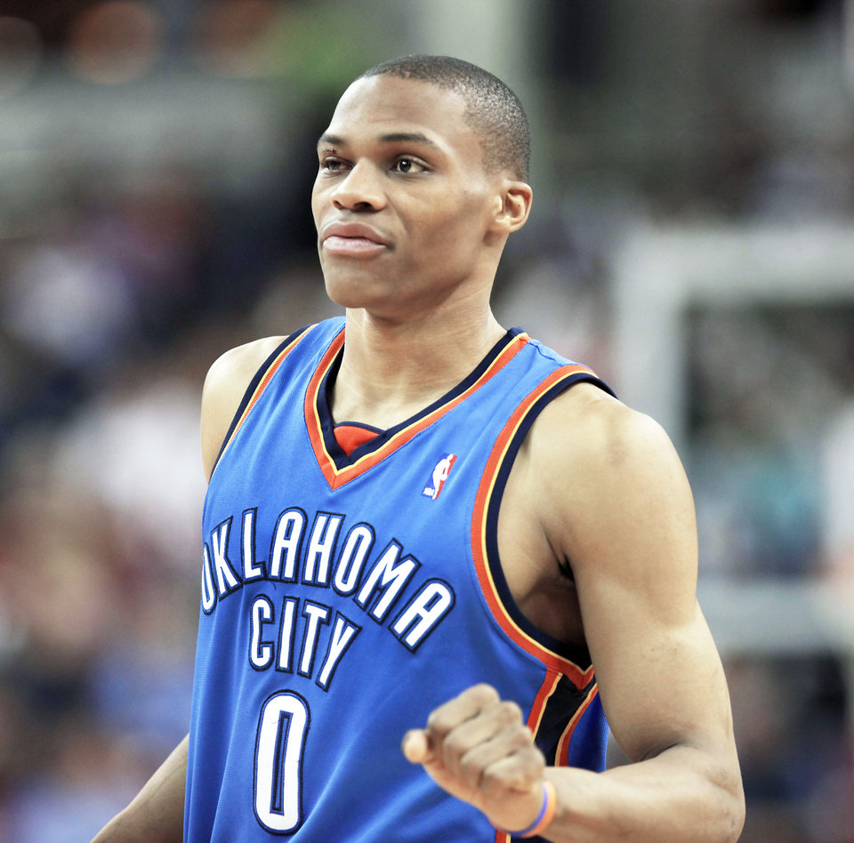 Photo - Thunder point guard Russell Westbrook returns to Sunday's 108-102 win over Sacramento with stitches over his right eye. Westbrook sustained the injury in the third quarter. AP PHOTO