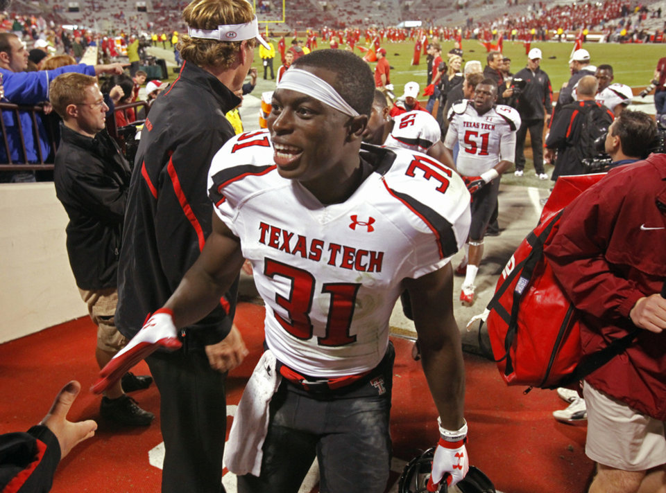 Texas Tech's Eugene Neboh (31) leaves the field after the game between the University of Oklahoma Sooners (OU) and Texas Tech University Red Raiders (TTU) at the Gaylord Family-Memorial Stadium on Sunday, Oct. 23, 2011. in Norman, Okla.  Tech won 41-38.  Photo by Steve Sisney, The Oklahoman