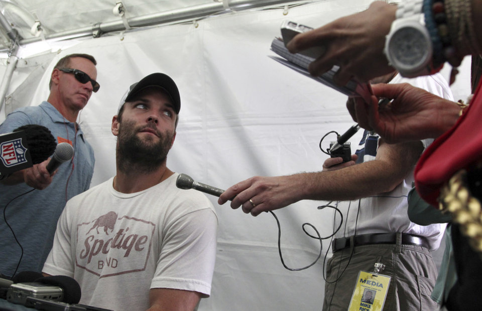 Photo - Denver Broncos wide receiver Wes Welker listens to a question as the NFL football team prepares for training camp, in Englewood, Colo., Wednesday, July 24, 2013. (AP Photo/Brennan Linsley)