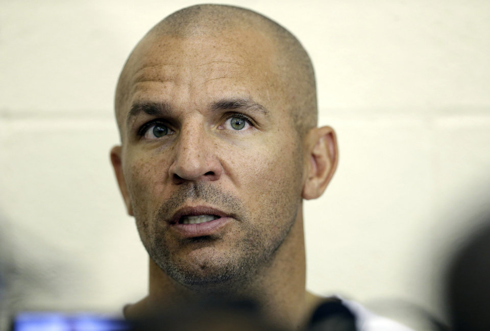 Photo - Brooklyn Nets coach Jason Kidd speaks with the media at NBA basketball training camp at Duke University in Durham, N.C., Wednesday, Oct. 2, 2013. (AP Photo/Gerry Broome)