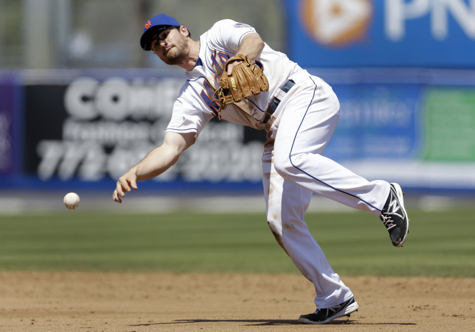 Photo - New York Mets second baseman Daniel Murphy throws St. Louis Cardinals' Matt Carpenter out at first during the fifth inning of an exhibition spring training baseball game Friday, March 29, 2013, in Port St. Lucie, Fla. (AP Photo/Jeff Roberson)