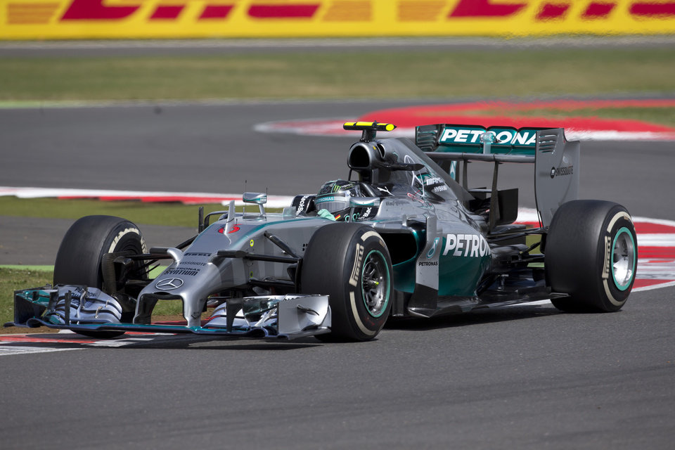 Photo - Germany's Nico Rosberg of Mercedes rounds a bend during the British Formula One Grand Prix at Silverstone circuit, Silverstone, England, Sunday, July 6, 2014. Rosberg failed to complete the race due to mechanical failure. Britain's Lewis Hamilton of Mercedes won the race, Finland's Valtteri Bottas of Williams finished second and Australia's Daniel Ricciardo of Red Bull finished third. (AP Photo/Jon Super)