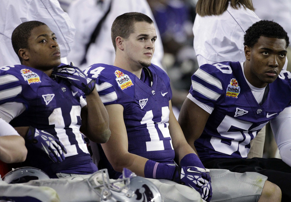 Kansas State wide receiver Tyler Lockett (16), Curry Sexton (14) and Tre Walker (50) during the second half of the Fiesta Bowl NCAA college football game, Thursday, Jan. 3, 2013, in Glendale, Ariz. Oregon won 35-17.(AP Photo/Matt York)