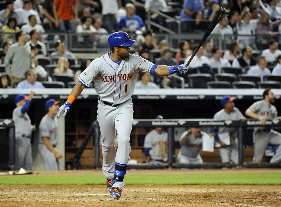 Photo - New York Mets' Chris Young watches his two-run home run off of New York Yankees relief pitcher Preston Claiborne in the eighth inning of an interleague baseball game at Yankee Stadium on Monday, May 12, 2014, in New York. (AP Photo/Kathy Kmonicek)